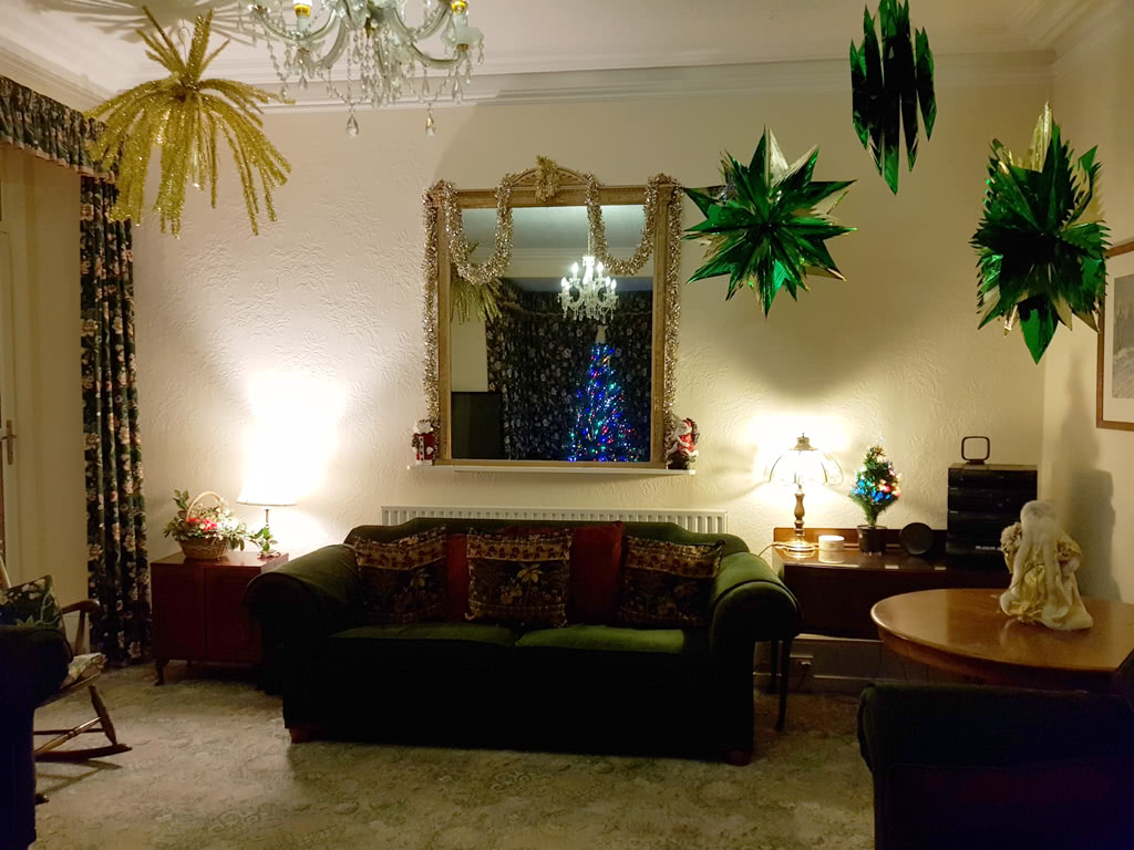 Christmas at the Grange, the lounge in front of the tree