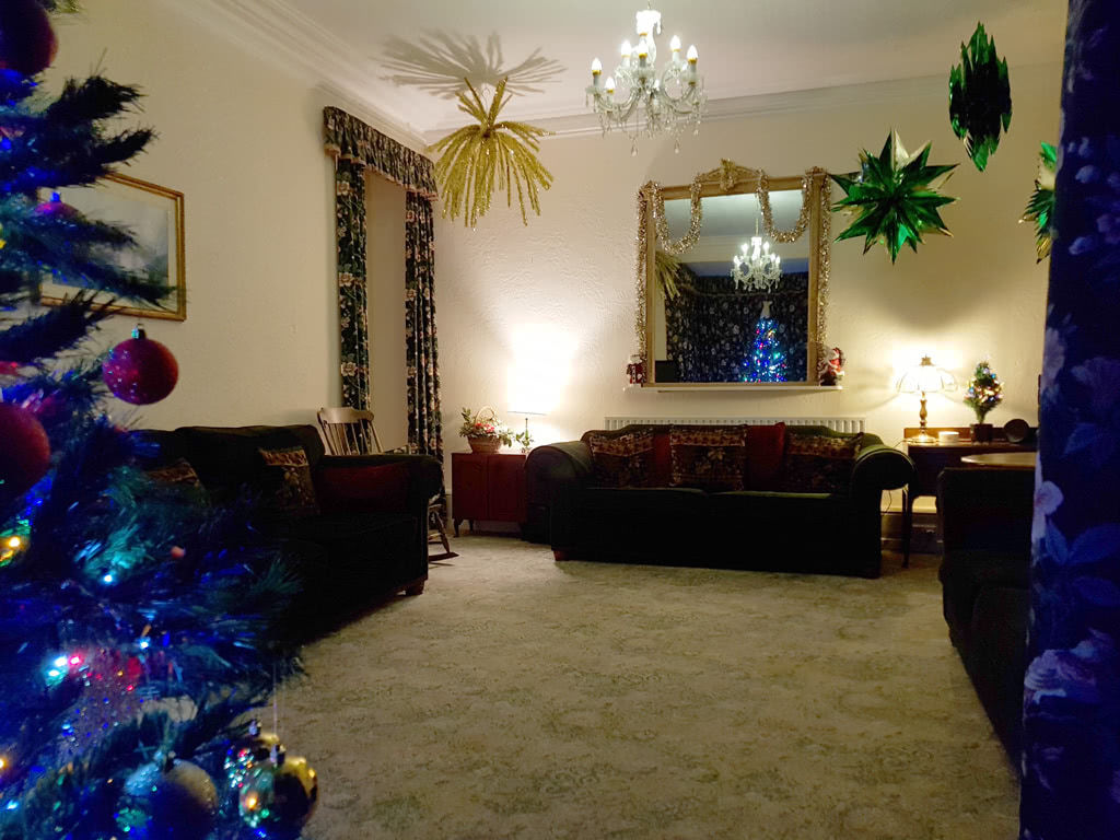 Christmas at the Grange, the lounge beside the tree