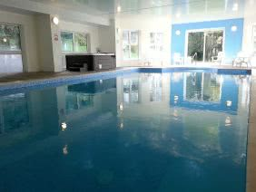 40' indoor heated swimming pool and hot tub